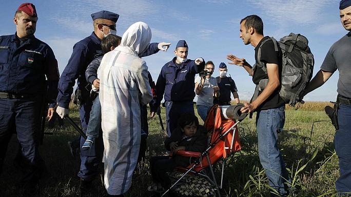 Hungarian police scuffle with migrants and refugees at Serbia border