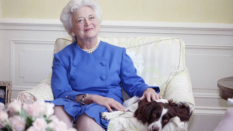 Image: First Lady Barbara Bush poses with her dog Millie in 1990.