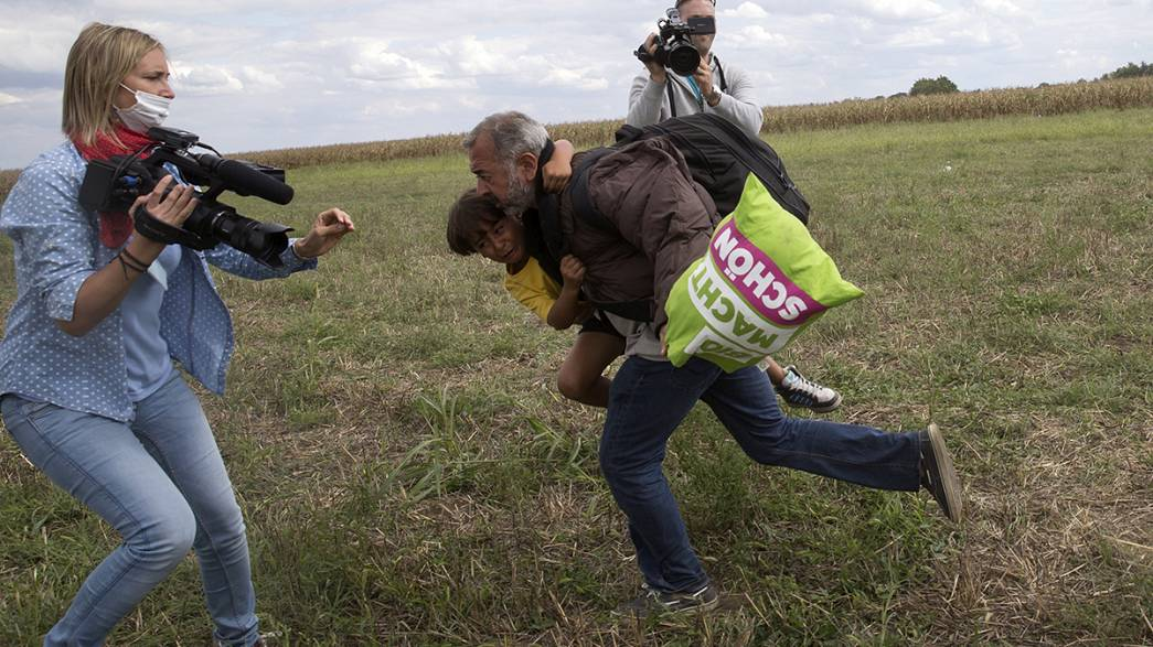 Hungarian camera woman caught on video kicking and tripping migrants could face jail