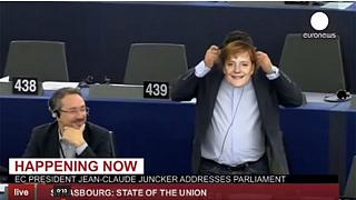 MEP wears Merkel mask in apparent anti-migrants protest