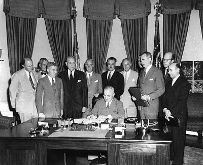 President Harry S. Truman signs the North Atlantic Treaty on April 4, 1949.
