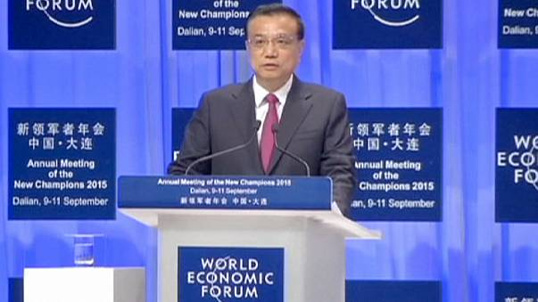 China's growth 'on track' despite slowdown, premier says