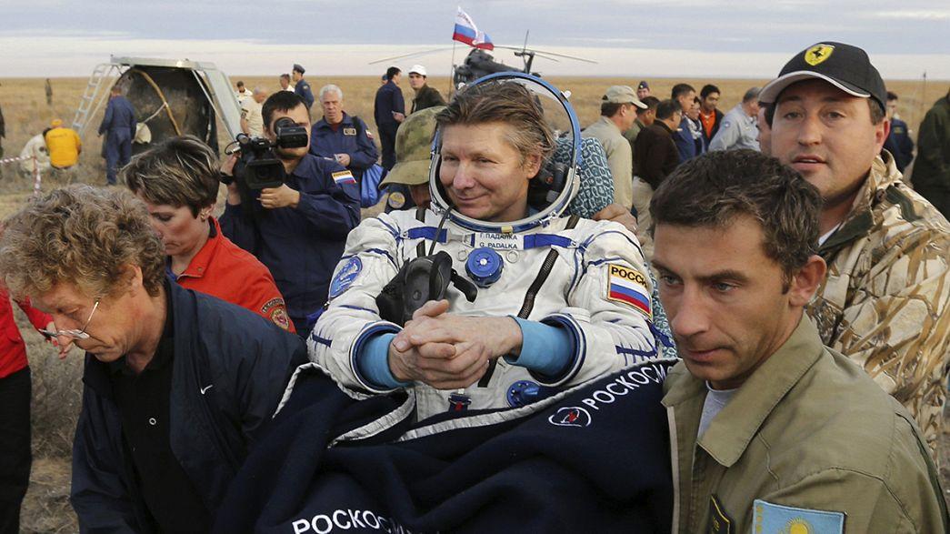 Record-breaking Russian cosmonaut returns to Earth
