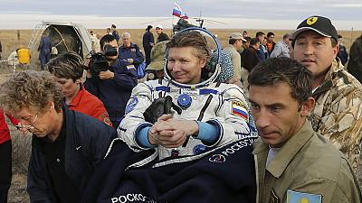Record-breaking Russian cosmonaut returns to Earth