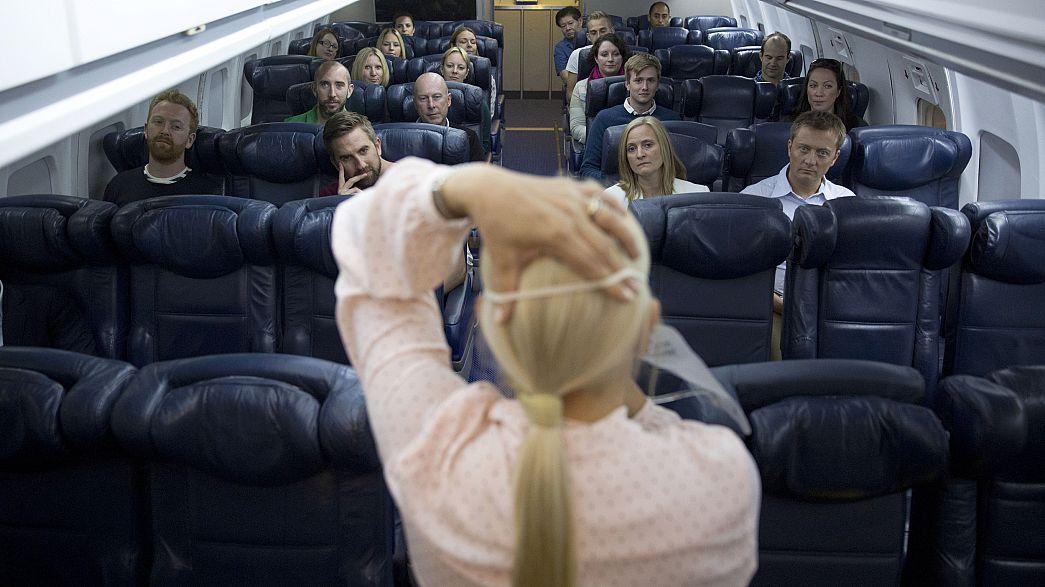 Image: British Airways flight safety instructor Diane Pashley demonstrates