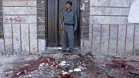 Image: At least nine killed and dozens in suicide bomb attack at voter regi