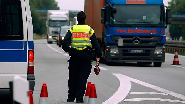 Migrants: queues build at border as Germany suspends Schengen