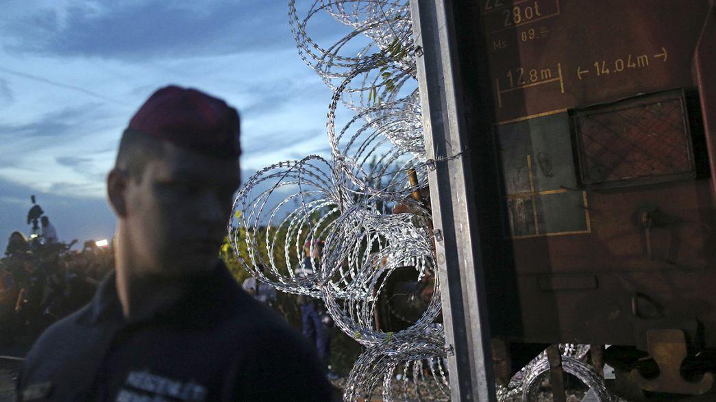 Hungary seals border with razor wire