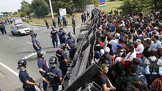 Refugees massed on Serbian border face long walk into Europe