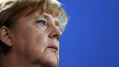 Merkel placates German regions over refugee numbers