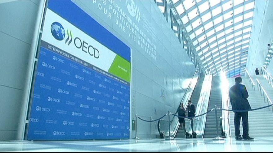 OECD says world economy set to grow less than estimated