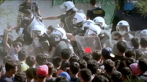 Riot police clash with migrants as tension rises in Lesbos