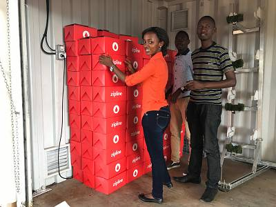 Workers prepare boxes for delivery in Rwanda.