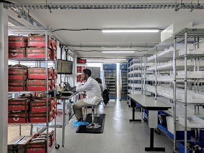 Technicians work inside Zipline\'s medical storage unit.
