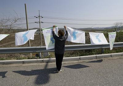 Unification flags are put up near Unification Bridge in Paju, South Korea, on Wednesday.