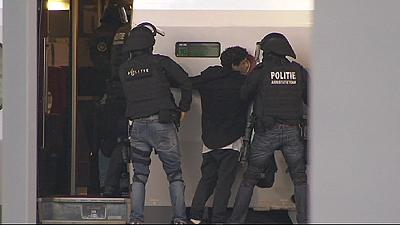 Rotterdam train suspect held by Dutch police after 'bomb threat'