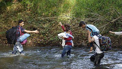Refugee path through Slovenia under threat as train traffic cut with Croatia