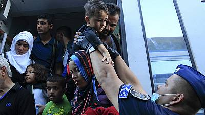 Confusion and contradiction as migrants cross into Hungary from Croatia