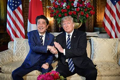 President Donald Trump greets Japanese Prime Minister Shinzo Abe at the Mar-a-Lago resort in Palm Beach, Florida, on April 17.