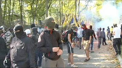 Masked protesters lay siege to Kharkiv City Hall in Ukraine