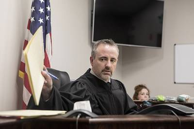 Circuit Judge Greg Howard leads a court session at the Cabell County Drug Court in Huntington.