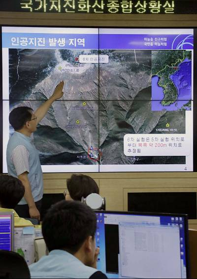 A South Korean official shows a map featuring the location of an artificial earthquake detected from North Korea\'s Punggye-ri nuclear test site on Sept. 3, 2017.