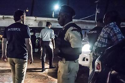 This photo made available by Interpol on April 30, 2018 shows Interpol officers during a raid in night clubs in Georgetown, Guyana, on April 7, 2018.