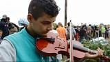 Young musician fleeing Syria dreams of peace