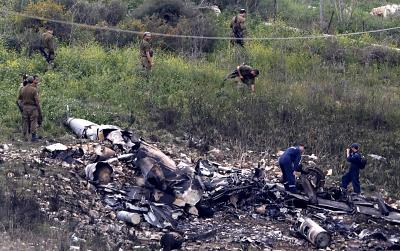 Israeli soldiers inspect the remains of an Israeli F-16 fighter jet in Harduf, Israel, that crashed after it was hit by a Syrian anti-aircraft system on Feb. 10, 2018. The crash followed reports from the Israelis that they successfully intercepted an Iranian drone that was launched from Syria and infiltrated Israeli airspace. In response, the Israeli\'s targeted Iranian locations in Syria.