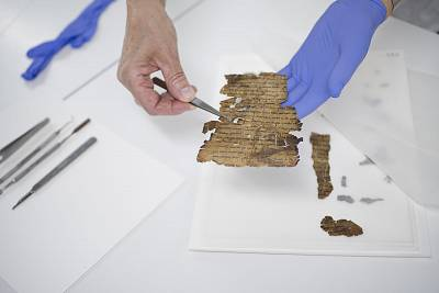 One of the Dead Sea Scroll fragments is examined at the Israel Antiquities Authority\'s lab.
