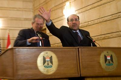 Iraqi Prime Minister Nouri al-Maliki reacts after Muntazer Zaidi threw his shoes at President George W. Bush in 2008.