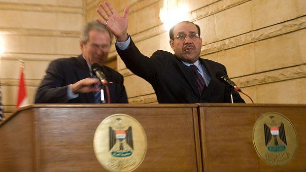 Image: Nouri al-Maliki and George W. Bush