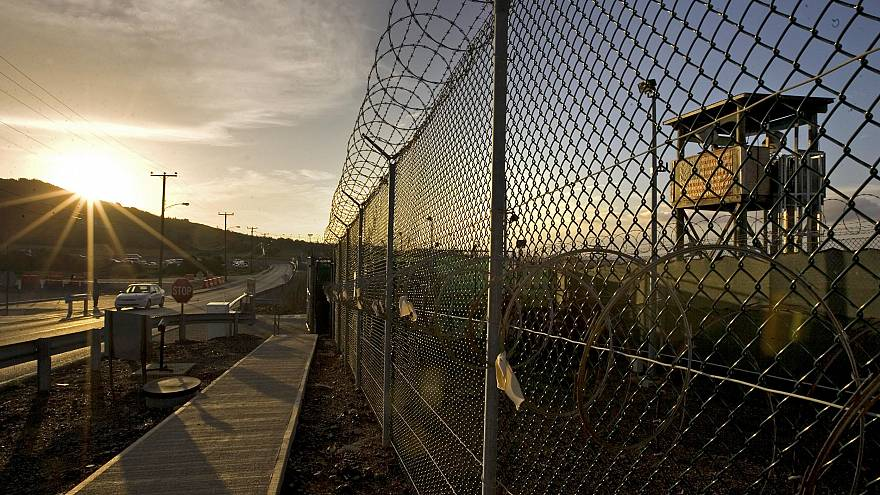 Image: The sun rises over Camp Delta detention compound at Guantanamo Bay