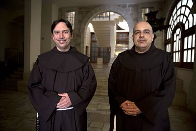 David Grenier, left, a Franciscan friar, and the Rev. Ramzi Sidawi at the Monastery of St. Saviour in Jerusalem.