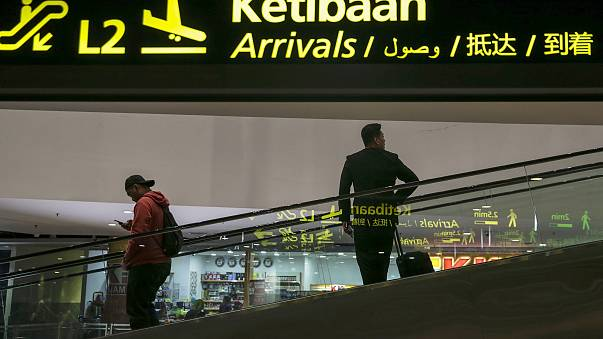 Image: People move inside the Kuala Lumpur International Airport, Malaysia,