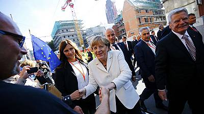 Merkel makes migrant plea as Germany marks 25 years of reunification
