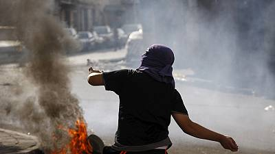 Israeli police and Palestinians clash after stabbing attacks