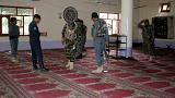 Image: Police inspect a mosque after a blast in Khost province, Afghanistan