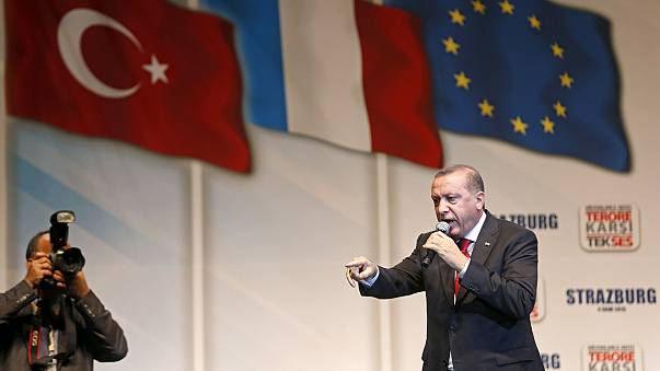 Turkish president accused of electioneering on foreign trip