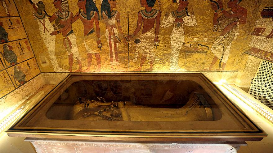 Image: The golden sarcophagus of King Tutankhamun in his burial chamber is