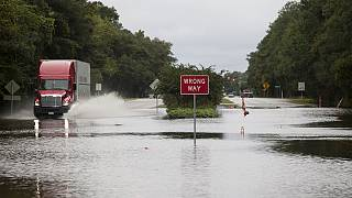 At least eight dead in floods in South and North Carolina