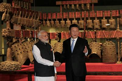 Indian Prime Minister Narendra Modi shakes hands Chinese President Xi Jinping during a visit to the Hubei Provincial Museum in Wuhan, China, on April 27.