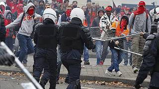 اشتباكات بين الشرطة البلجيكية ومتظاهرين خلال مسيرة ضد الاجراءات التقشفية الجديدة