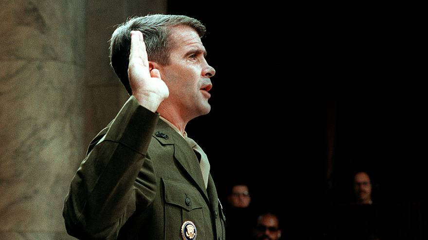 Image: Oliver North is sworn before the House and Senate Foreign Affairs Co