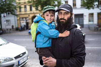 Berlin resident Avraham Granov and his son Baruch outside of a Jewish kindergarten in Berlin.