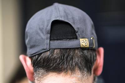 A Jewish man in Berlin hides his kippah under a baseball cap.