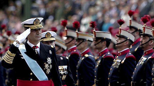 Spain's King Felipe presides over national day parade