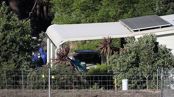 Image: Police forensics investigate the death of seven people