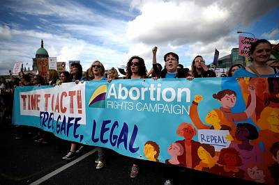 Demonstrators hold posters as they march for more liberal abortion laws in Dublin, Ireland, on Sept. 30.