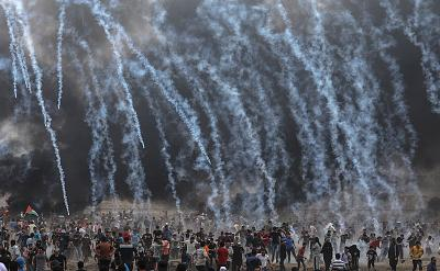 Israeli soldiers fire tear gas at Palestinian protesters during clashes in eastern Gaza City on May 4.